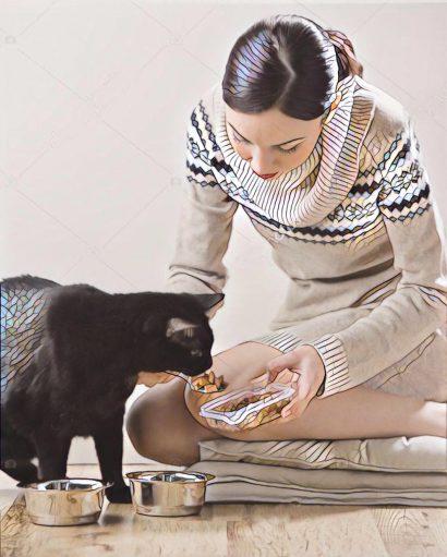 Meisje voert kat